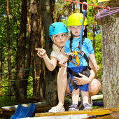 Mom and son climbing the trees — Stock Photo