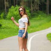Girl in glasses outdoors — Stock Photo