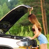 Girl in bikini with car — Stock Photo