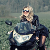 Woman on motorcycle — Stock Photo
