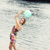 Woman on water with balloon — Stock Photo