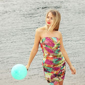 Woman on beach with balloon — Stock Photo
