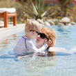 Mother and her son in the pool — Stock Photo #12569469