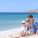 Family at the beach — Stock Photo
