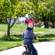 Toddler on a balance bike — Stock Photo #13170061