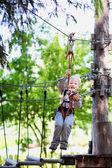 Little boy ziplining — Stock Photo