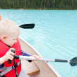 Father and son on a lake — Stock Photo