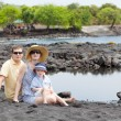 Family at the black sand beach — Stock Photo