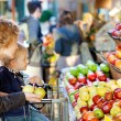 Family at farmers market - Stock Photo