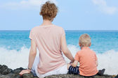 Mother and her son at the beach — Stock Photo