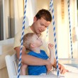 Father and son on a swing — Stock Photo