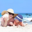 Mother and her child at a beach — Stock Photo