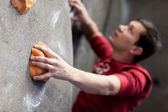 Rock climbing indoors — Stock Photo