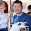 Family at the amusement park — Stock Photo