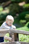 Sad child outdoors — Stock Photo