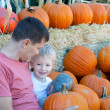 Family of two at pumpkin patch — Stock Photo