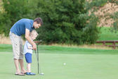 Family of two at the golf course — Stock Photo