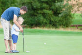 Family playing golf — Stock Photo