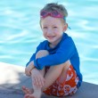 Kid by the swimming pool — Stock Photo #30013359
