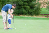 Family golfing — Stock Photo