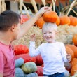 Family at pumpkin patch — Stock Photo #30306637