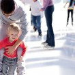 Family ice skating — Stock Photo #30306681