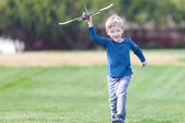 Boy playing toy plane — Stock Photo