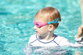 Child in the pool — Stock Photo