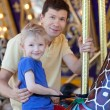 Family at amusement park — Stock Photo