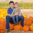 Family at the pumpkin patch — Stock Photo