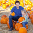 Family at the pumpkin patch — Stock Photo #33212653
