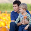 Family at the pumpkin patch — Stock Photo #33212715
