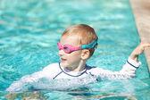 Boy at swimming pool — Stock Photo