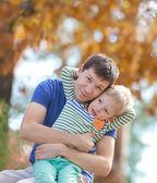Family at fall — Stock Photo