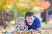 Family at autumn — Stock Photo