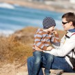 Family hiking at the beach — Stock Photo #35832245