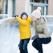 Family ice skating — Stock Photo #36957683