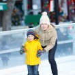 Family ice skating — Stock Photo #36957701