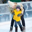 Family ice skating — Stock Photo #36957711