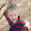 Kid at the swing — Stock Photo