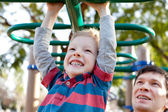 Family at kids playground — Stock Photo