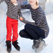 Family ice skating — Stock Photo #38687847