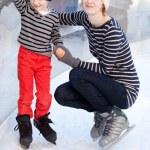 Family ice skating — Stock Photo