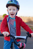 Kid riding bike — Stock Photo