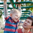 Family at the playground — Stock Photo