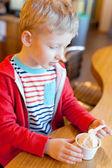 Boy eating ice-cream — Stock Photo