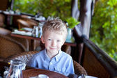 Boy in cafe — Stock Photo