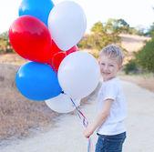 Boy celebrating 4th of July — Stock Photo