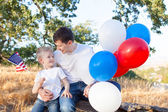 Family celebrating 4th of July — Stock Photo
