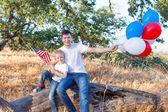 Family celebrating 4th of July — Stock Photo